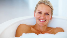 Woman bathing with Ultra Epsom Salt